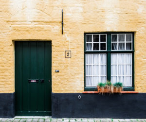 green door and window home exterior