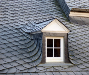 gray roof shingles atop window dormer