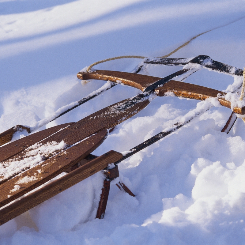 wooden sled in snow